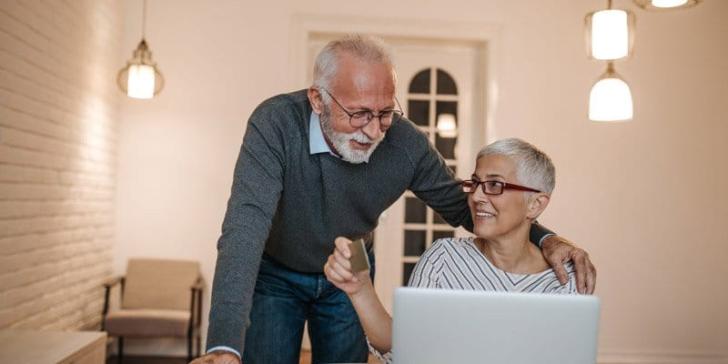 Elderly couple using computer